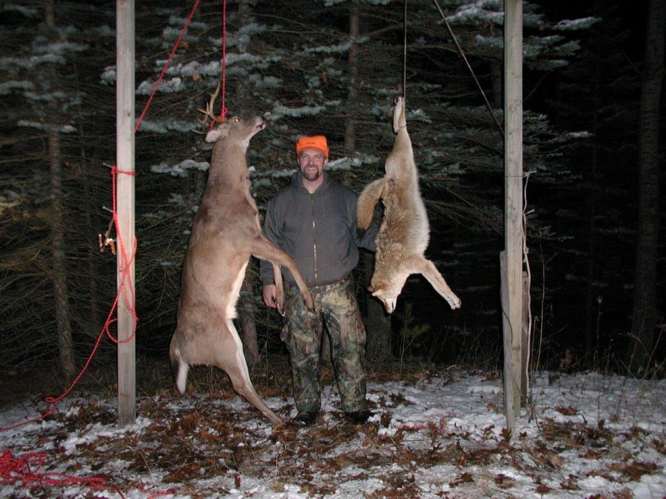 todd-taylor-with-deer-and-coyote