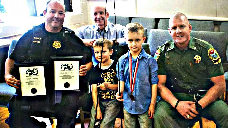 Sons of Fallen Police Officer Receive Lifetime Fishing, Hunting Licenses