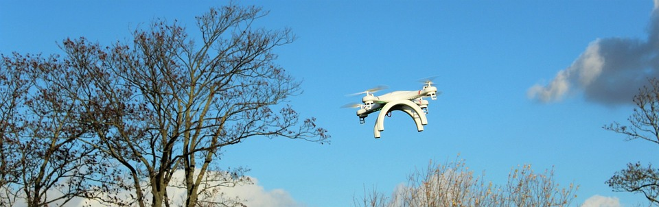 drone-flying-over-treetops
