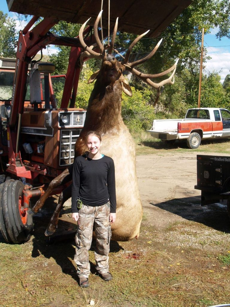 hannah-helmer-standing-with-state-record-elk-hanging