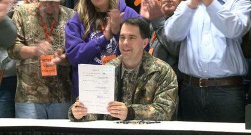 scott-walker-signs-bill-outlawing-hunter-harassment